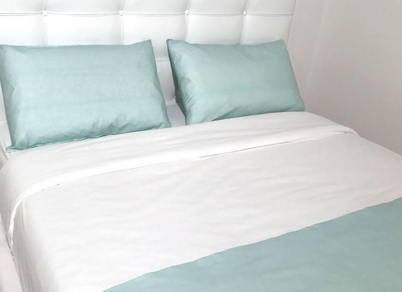Taies d'oreiller et jetés de lit colorés jetés de lit bio color